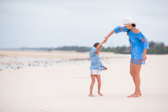 Happy family during summer vacation on white beach Royalty Free Stock Photography