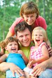 Happy family in  summertime Stock Photography