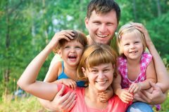 Happy family in  summertime Royalty Free Stock Photos