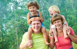 Happy family in  summertime Royalty Free Stock Image