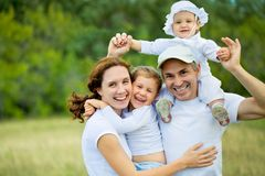 Happy family in  summertime Stock Photos