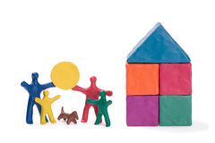 Happy family and sun. A happy family, a new house and the sun. Abstract Stock Photography