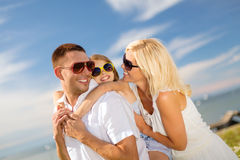 Happy family in sunglasses having fun outdoors Stock Images