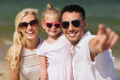 Happy family in sunglasses on summer beach Royalty Free Stock Photo
