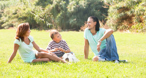Happy family  in sunny park Stock Images