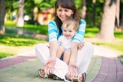 Happy family in sunny park Stock Photos