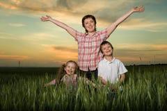 Happy family at sunset Stock Photos