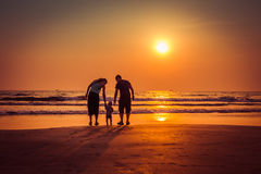 Happy family on sunset beach in Arambol beach, North Goa, India Stock Photography
