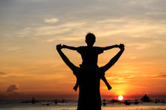 Happy family on sunset beach. Father and son on sunset beach, happy family Royalty Free Stock Photos