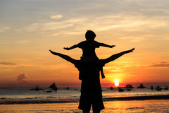 Happy family on sunset beach Stock Images