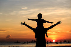 Happy family on sunset beach Royalty Free Stock Photo