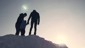 Happy family at sunset. Father, mother and little son are having fun and playing on snowy winter walk in nature. stock video footage