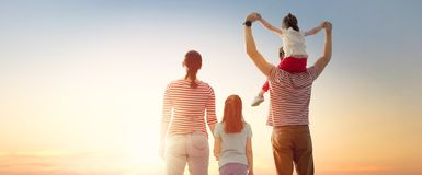 Happy family at sunset stock images
