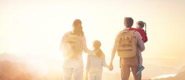 Happy family at sunset stock photo