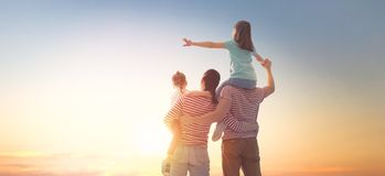 Happy family at sunset stock photos