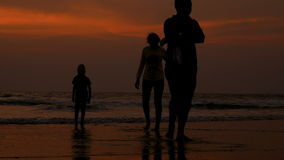 Happy family at sunset stock video