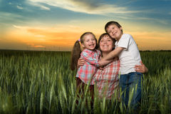 Happy family at sunset Royalty Free Stock Images