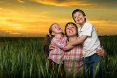Happy family at sunset Royalty Free Stock Photography