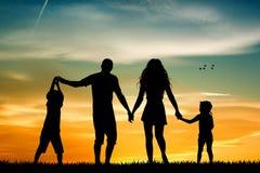 Happy family at sunset Royalty Free Stock Photos