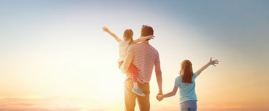 Happy family at sunset stock image