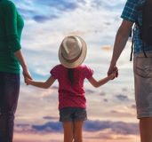 Happy family at sunset. Stock Image