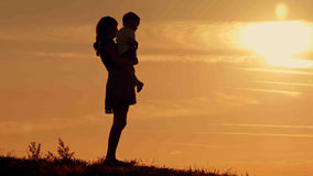 Happy family on sunset silhouette Royalty Free Stock Photography