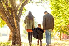 Happy family at sunset walking in the beach royalty free stock photography