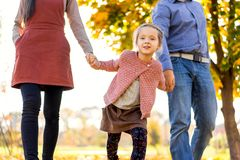 Happy family at sunset walking in the park in autumn royalty free stock photography