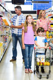 Happy family at the supermarket Royalty Free Stock Images