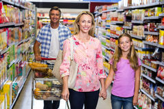 Happy family in the supermarket Stock Photo