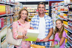 Happy family in the supermarket Royalty Free Stock Photo
