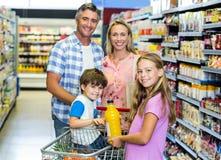 Happy family at the supermarket Royalty Free Stock Photo
