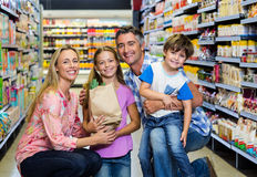 Happy family at the supermarket. Portrait of happy family at the supermarket Stock Photos