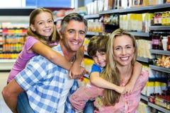 Happy family at the supermarket Stock Photos