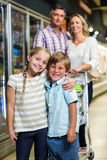 Happy family at the supermarket Stock Images