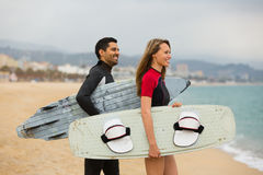Happy family with surf boards Stock Photos