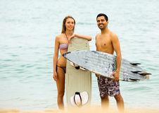 Happy family with surf boards Royalty Free Stock Photography