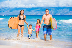 Happy Family with Surfboards Royalty Free Stock Photo