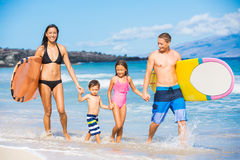 Happy Family with Surfboards Royalty Free Stock Photography