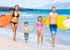 Happy Family with Surfboards Stock Photo
