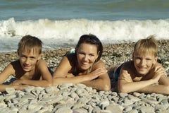 Happy family swim Stock Images