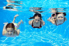 Happy family swim underwater in pool. And having fun, mother and children on vacation Royalty Free Stock Image