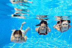 Happy family swim underwater in pool Royalty Free Stock Photography