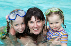 Happy family in swimming pool. Royalty Free Stock Photo