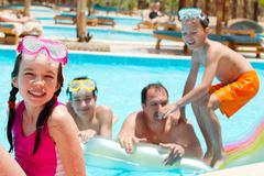 Happy family in swimming pool Royalty Free Stock Images