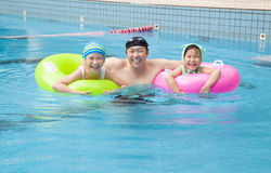 Happy family in the swimming pool Royalty Free Stock Photo