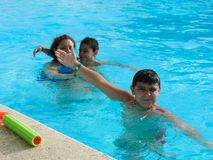Family swimming at pool. Happy family swimming at pool Royalty Free Stock Images