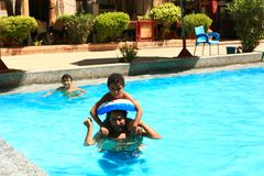 Happy Family at swimming pool. Happy family swimming at pool Royalty Free Stock Photos