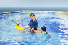 Happy family swimming on the pool 1. Happy family playing on the swimming pool together Stock Photo