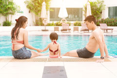 Happy family in swimming pool. Summer holidays and vacation conc Royalty Free Stock Image